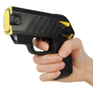 pulse plus taser with laser and 2 live cartridges held in hand