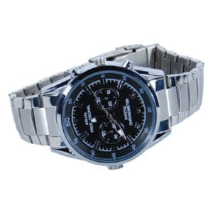 hd watch with hidden camera and silver band laying on side