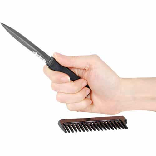 black comb knife in hand opened in hand