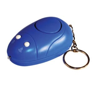 sitting on table blue personal alarm key chain and light