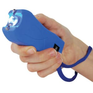 green runt stun gun rechargeable with wrist strap disable pin in hand