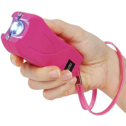 pink runt stun gun rechargeable with wrist strap disable pin in hand