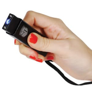 stun gun slider with LED flashlight and USB recharger black in hand