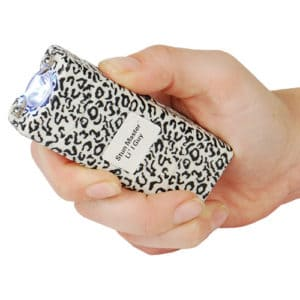 silver lil guy stun gun with flashlight in hand