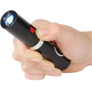 black lipstick stun gun with flashlight and rechargeable battery in hand