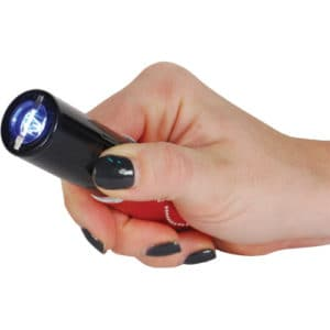 red lipstick stun gun with flashlight and rechargeable battery in hand
