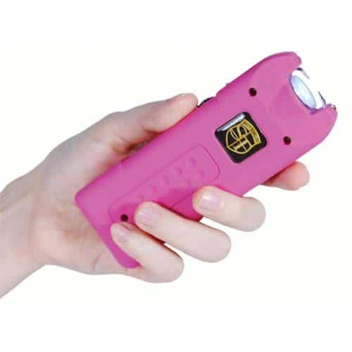 pink rechargeable with alarm and flashlight multiguard stun gun in hand
