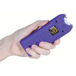 purple rechargeable with alarm and flashlight multiguard stun gun in hand