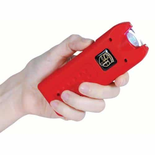 red rechargeable with alarm and flashlight multiguard stun gun in hand