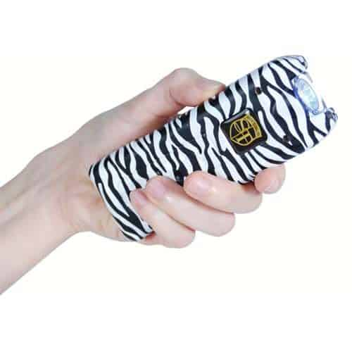 zebra print rechargeable with alarm and flashlight multiguard stun gun in hand