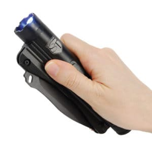 flashlight stun gun knife shown in hand in holster