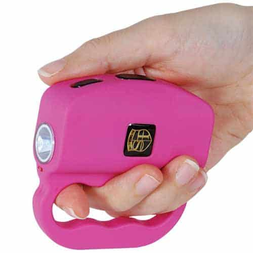 pink talon flashlight with stun gun side view in hand