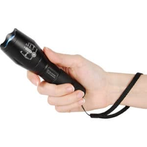 zoomable 1200 lumen led flashlight for self defense in hand